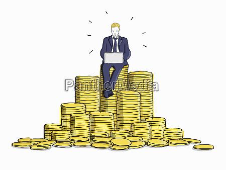 businessman using laptop sitting on top