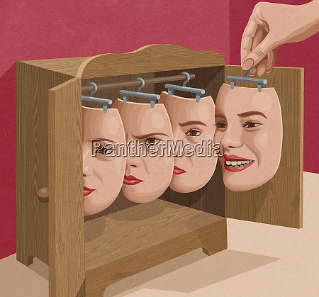 woman choosing facial expression mask from