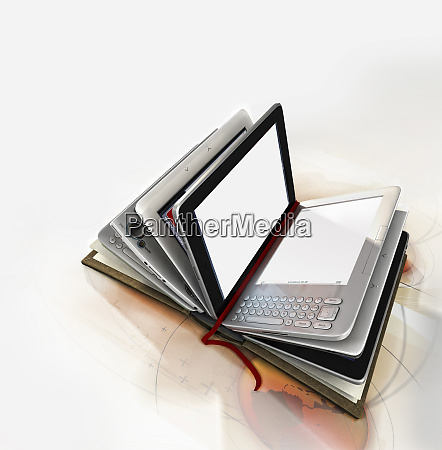 book with digital tablet pages