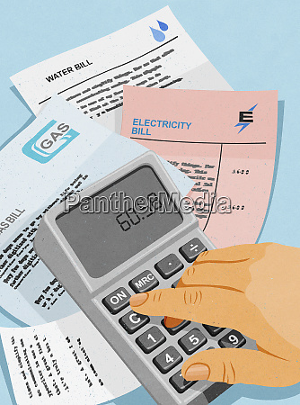 man paying utility bills and using