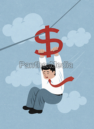 terrified businessman holding on to dollar