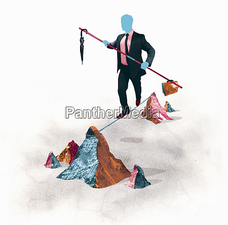 businessman balancing on tightrope between mountain