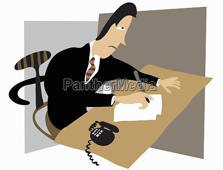 stressed businessman writing at desk