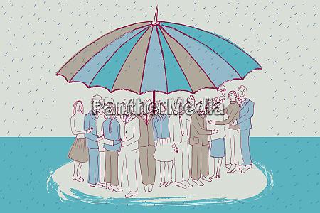 people huddling together under large umbrella