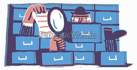 man hiding in filing cabinet reading