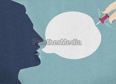 womans hand bursting mans speech bubble