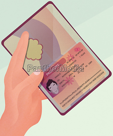 hand holding passport open