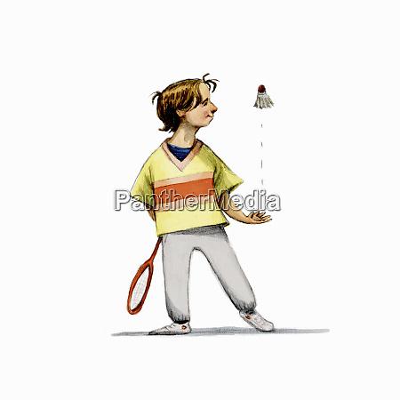 boy throwing up badminton shuttlecock ready