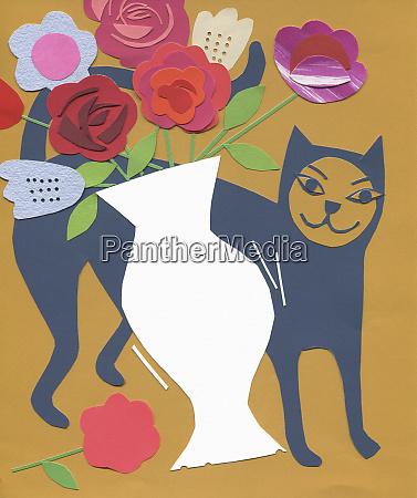cat knocking flower vase over