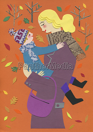autumn leaves falling around mother hugging