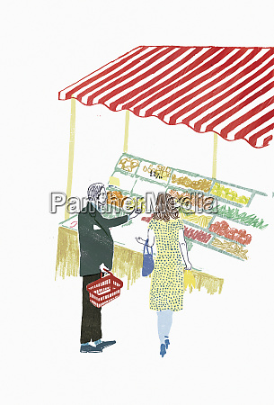 man and woman choosing fruit and