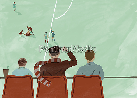 father watching football match with sons