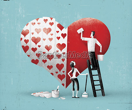 couple decorating large heart with wallpaper