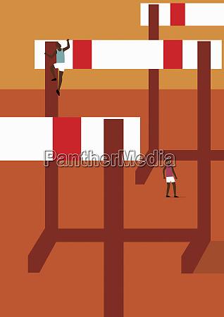 athlete climbing huge hurdle
