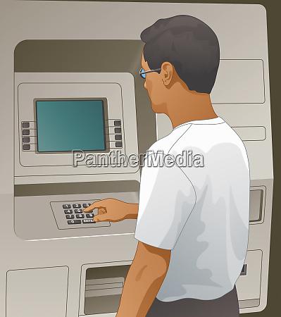 man using keypad on cash machine