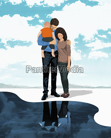 family standing on the edge of