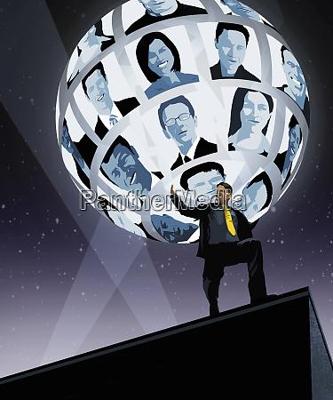 businessman struggling to support global network