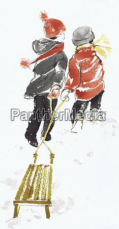 girl and boy pulling toboggan together