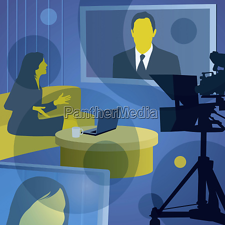 woman interviewing man on visual screen