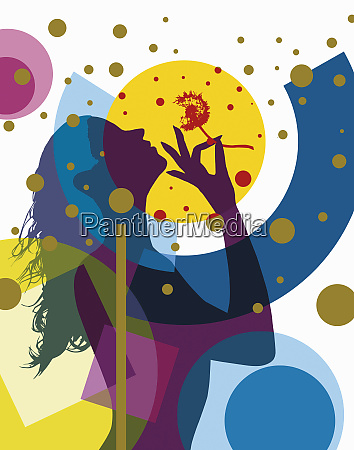 silhouette of woman blowing dandelion seeds