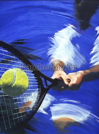 tennis player hitting tennis ball