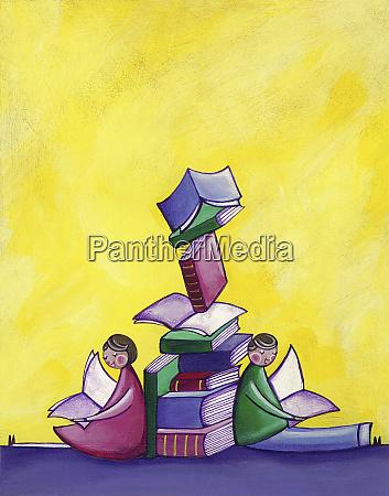 children sitting reading leaning against pile