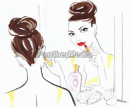 beautiful woman applying red lipstick in