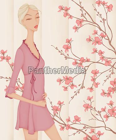 beautiful elegant woman wearing pink mini