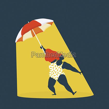 curvaceous woman in sunshine beneath umbrella