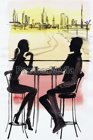 young couple in cafe silhouetted against