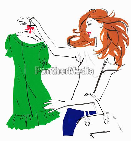 beautiful woman shopping admiring green dress