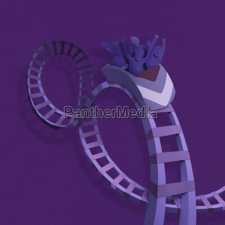 family on rollercoaster ride in paper