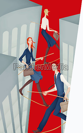 business people walking tightropes between skyscrapers