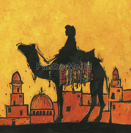 silhouette of camel and rider against