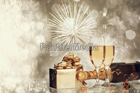 glasses of champagne on holiday background