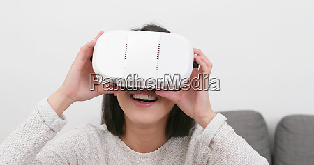 woman watching with vr device at