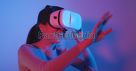 woman looking with virtual reality with