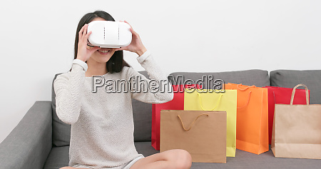 woman using virtual reality device for