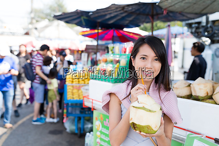 woman enjoy coconut juice in wet