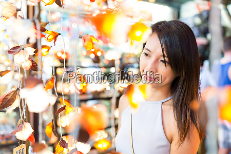 asian woman shopping in market