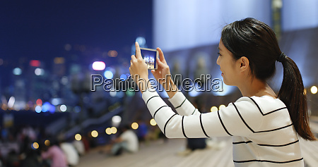 woman taking video by cellphone in