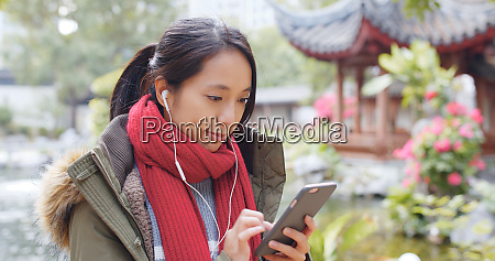 woman listen to music and wearing