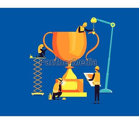 builders assembling large trophy