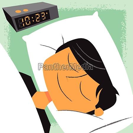 smiling, man, sleeping, next, to, alarm - 26028061