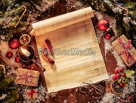 parchment scroll with christmas decorations