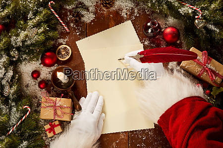santa claus writing with a vintage
