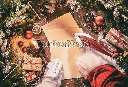 father christmas writing a seasonal letter