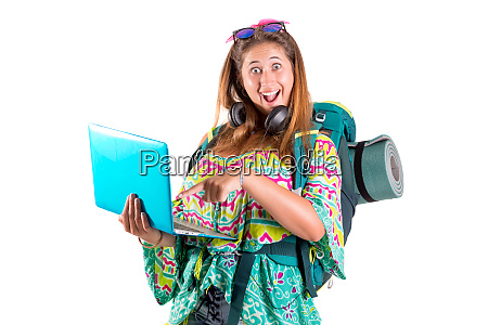 traveling girl with backpack and laptop