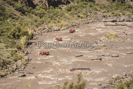 rafting with three red rubber boats