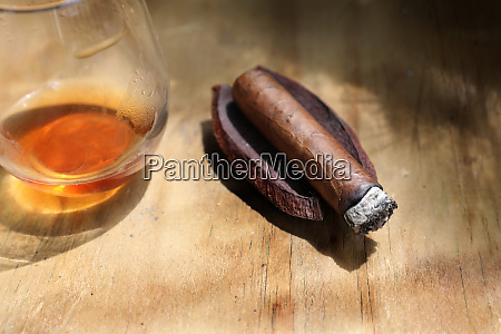 close up cigar and drink on